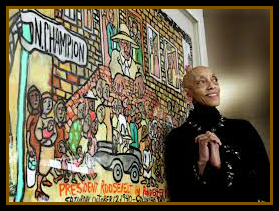 Aminah Robinson in front of her art