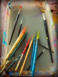 Paint Brushes Floating in Water