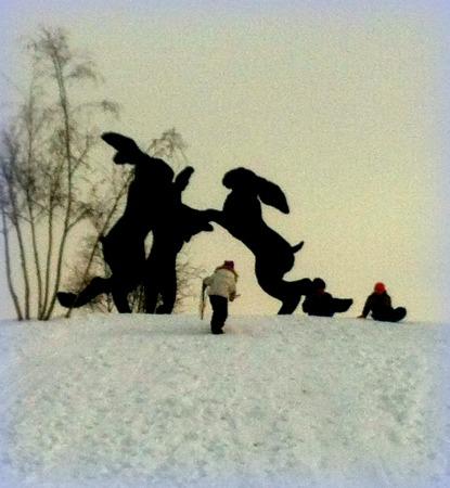 Kids Sledding Near Dancing Bunnies Sculpture