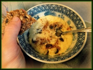 A bowl of Rice Pudding with an Oatmeal Cookie