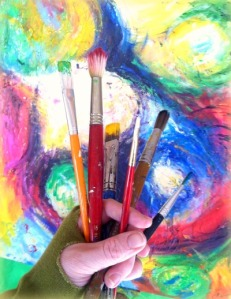 A Fistful of Brushes in front of painting
