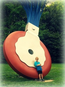 Boy leaning against giant eraser