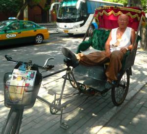 When I approached this rickshaw driver I indicated I'd like to take his picture by holding up my camera and nodding my head.  He nodded back.  I took the picture and nodded my head again to indicate thanks.  He nodded back.  A myriad of words can be conveyed in a nod!