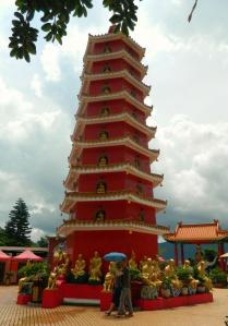 10,000 Buddhas Monestary. The figures in the front were carrying an umbrella not because of rain but because of heat!