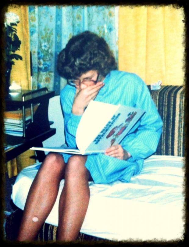 Girl reading with a run in her hose.